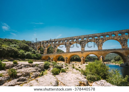 Famous landmark Ancient old Double arches of the Roman aqueduct of Pont du Gard, Nimes, France - stock photo