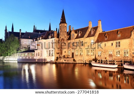Famous location the Rozenhoedkaai, at night in Bruges, Belgium. - stock photo