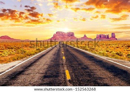 famous long road in front of Monument Valley, USA - stock photo