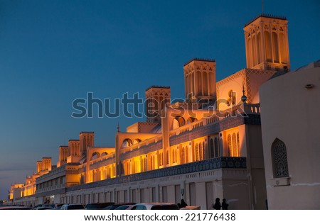 Famous marketplace of Sharjah (UAE), Blue Souk; the building is illuminated, photo is takes just after sunset.