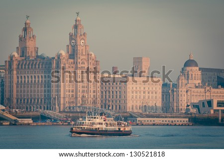 Famous Mersey Ferry in front of the Liver Building - stock photo