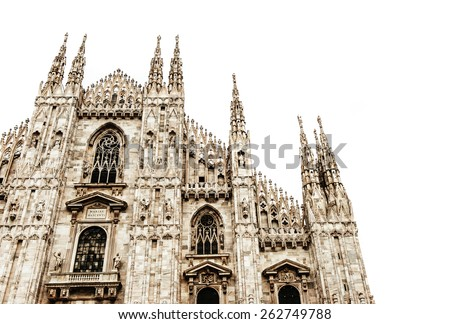 Famous Milan Cathedral is the fifth largest cathedral in the world. Detail of the front isolated on white Milan, Italy - stock photo