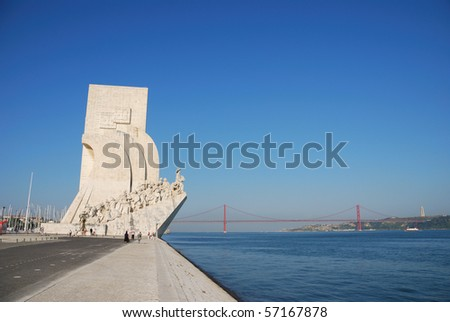 famous monument to the maritime discoveries in Lisbon, Portugal (April 25th bridge on the background) - stock photo