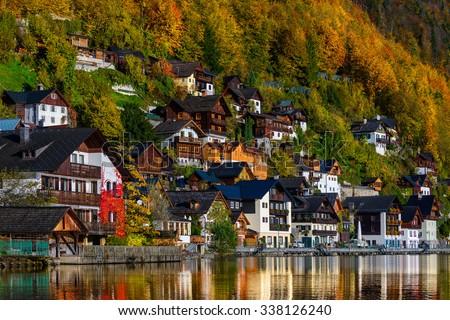 Famous mountain village and alpine lake, Austrian Alps - stock photo