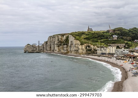 Famous natural cliffs in Etretat. Etretat is a commune in Seine-Maritime department in Haute-Normandie region in France. Etretat is now a famous French seaside resort.