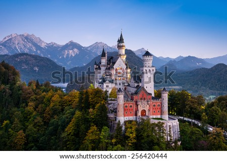 Famous Neuschwanstein Castle in Bavaria, Germany, before sunrise - stock photo