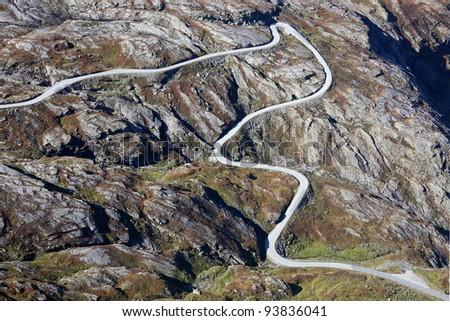"""Famous Norwegian """"Troll's Path"""" (Trollstigen or Trollstigveien) - winding mountain road - stock photo"""