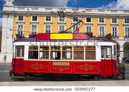 Famous old red tram on street of Lisbon/Lisboa.Plaza de comercio