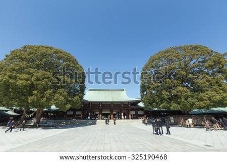 Famous old Shinto shrine in Tokyo city on a sunny winter day, Meiji Shrine - stock photo