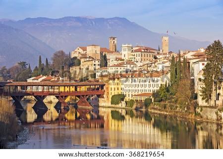 Famous old wooden bridge (Ponte Vecchio) in village Bassano del Grappa, Italy - stock photo