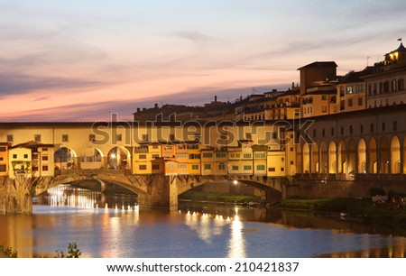 Famous Ponte Vecchio with river Arno at sunset in Florence, Tuscany, Italy