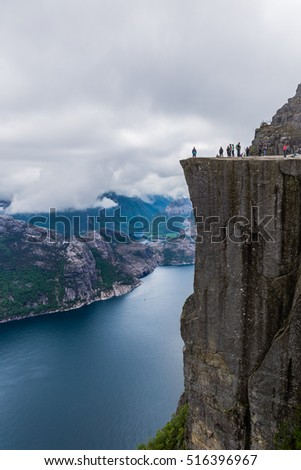 Famous Preikestolen rock in Norway, overlooking a fjord, it is a steep cliff which rises 604 metres