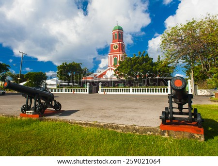 Famous red clock tower on the main guardhouse at the Garrison Savannah. UNESCO garrison historic area Bridgetown, Barbados - stock photo