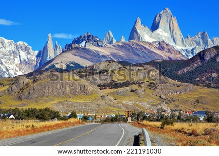 Famous rock Fitz Roy peaks in the Andes. Magnificent panorama of snow-capped mountains in Patagonia. Excellent highway in El Chalten - stock photo