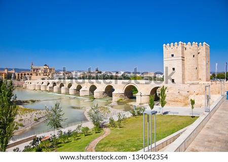 Famous Roman bridge and Guadalquivir river in Cordoba, Andalusia, Spain. - stock photo