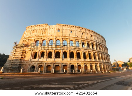 famous ruins of Colosseum at sunrise in Rome, Italy - stock photo