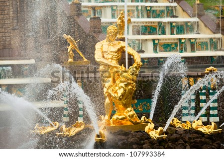 Famous Samson and Lion fountain in Peterhof Grand Cascade in St. Petersburg, Russia. - stock photo