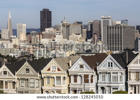 Famous San Francisco victorian homes and skyline. - stock photo