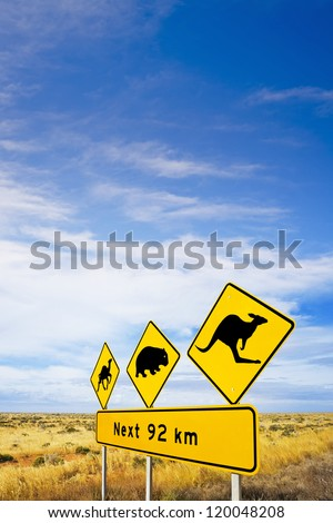 Famous sign on Nullarbor Plain, South Australia, warning motorists of camels, wombats and kangaroos, and big sky. - stock photo