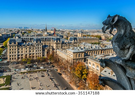 Famous Stone demons gargoyle and chimera with Paris city on background. View from Notre Dame de Paris. France.
