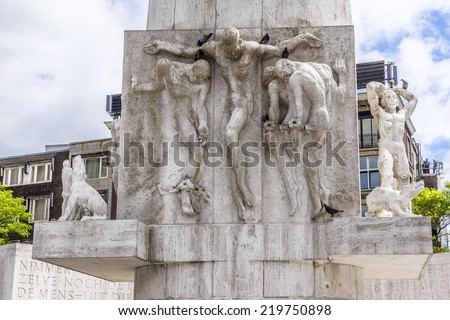 Famous stone pillar - National Monument (designed by architect Oud, erected in 1956) on Dam Square to memorialize the victims of the World War II. Amsterdam, Netherlands.  Fragment. - stock photo