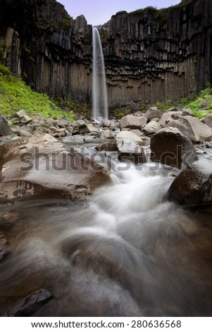 Famous Svartifoss waterfall (Black Waterall) - popular tourist spot in Iceland's Skaftafel national park (Island) - stock photo