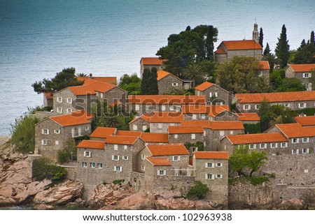 Famous Sveti Stefan (now Aman Sveti Stefan) including the Villa Milo?er is a small islet and Luxury hotel resort in Montenegro, approximately 6 kilometers southeast of Budva, Europe - stock photo