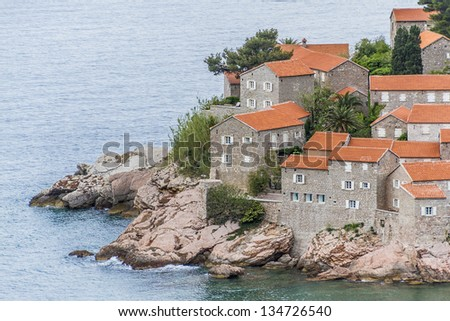 Famous Sveti Stefan (now Aman Sveti Stefan) including the Villa Milocer is a small islet and Luxury hotel resort in Montenegro, approximately 6 kilometers southeast of Budva, Europe - stock photo