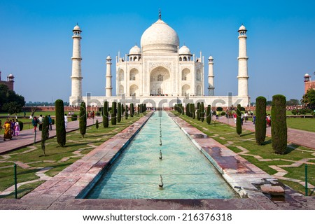 Famous Taj Mahal mausoleum in in bright clear day, Agra, India, UNESCO world heritage site - architecture wallpaper - stock photo