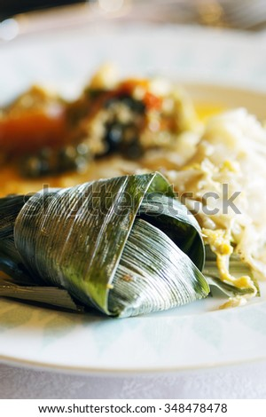 Famous Thai food - chicken wrapped in screwpine (pandan) leaf.                                - stock photo