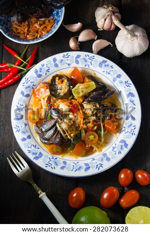 """Famous Thai food,  """"Somtum"""" in Thai spicy papaya salad with salted crab - stock photo"""