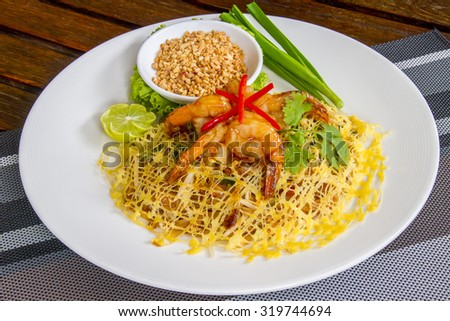 Famous Thai's dish Phad thai. Fried noodle with shrimp - Halal Food - stock photo