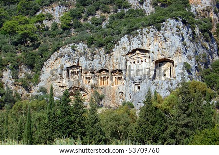 Famous tombs carved inside rocks in ancient Kaunos city, Turkey. - stock photo
