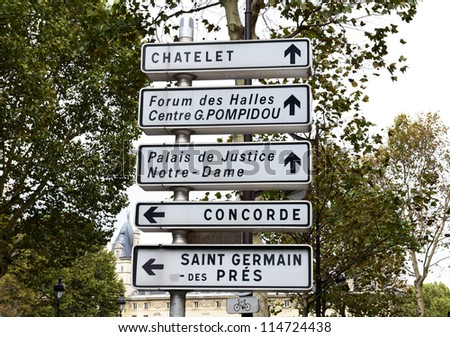 Famous tourist landmark on signpost in Paris, Europe - stock photo
