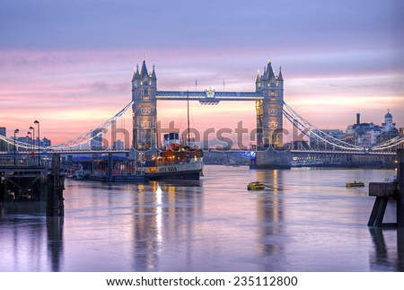Famous Tower Bridge in front of colorful sky at morning before sunrise, HDR image, London, England, United Kingdom - stock photo