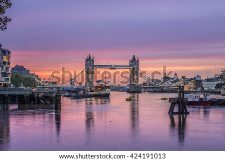 Famous Tower Bridge in front of colorful sky at morning before sunrise, London, England, United Kingdom