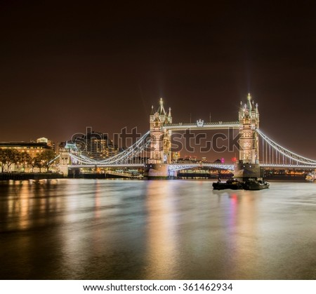 Famous Tower Bridge in London at night - stock photo