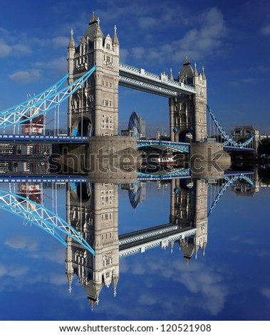 Famous Tower Bridge in London with tourist boat,  England - stock photo