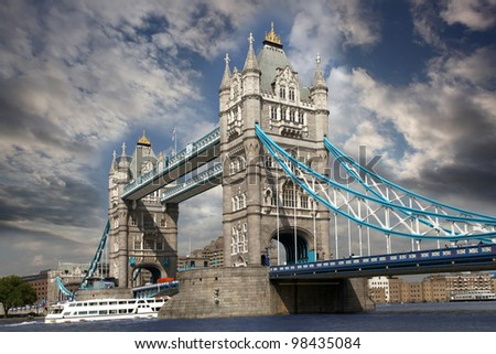 Famous Tower Bridge with boat in  London, UK - stock photo