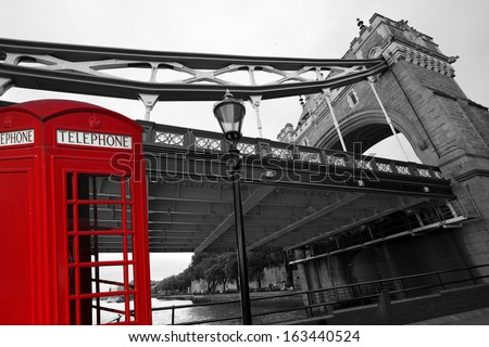 Famous Tower Bridge with typical red telephone box in London, England - stock photo