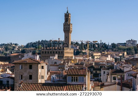 Famous tower of Palazzo Vecchio or Palazzo della Signoria (The Old Palace). Aerial view from Giotto's Campanile. Florence, Tuscany, Italy. - stock photo