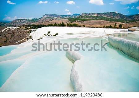 Famous travertine pools and terraces in Pamukkale Turkey - stock photo