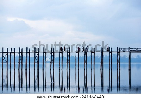 Famous U-Bein teak bridge on Taungthaman lake in Amarapura, Mandalay division, Myanmar - stock photo
