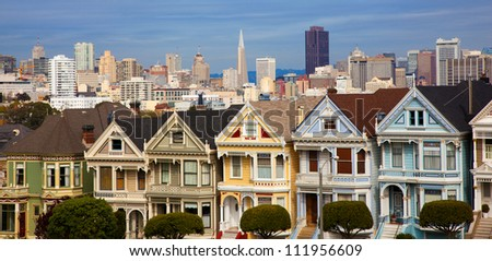 Famous Victorian row houses in San Francisco with skyline.  Houses referred to as the painted ladies