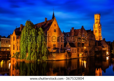 Famous view of Bruges-  Rozenhoedkaai with Belfry and old houses along canal with tree. Brugge, Belgium - stock photo