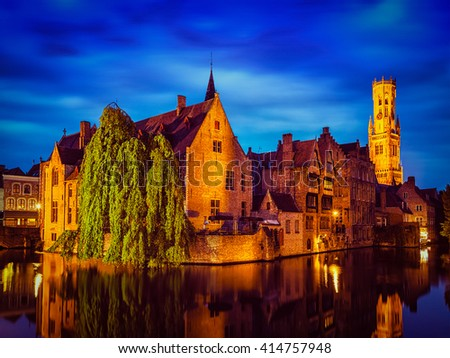 Famous view of Bruges-  vintage retro effect filtered hipster style image of Belfry and old houses along canal with tree. Brugge, Belgium - stock photo
