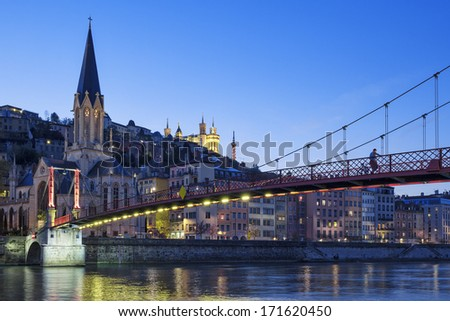Famous view of church in Lyon with Saone river at night - stock photo