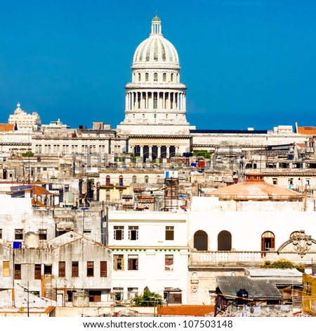 Famous view of Havana including the dome of the Capitol against a clear blue sky and parts of the old town - stock photo