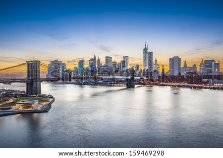 Famous view of New York City over the East River towards the financial district in the borough of Manhattan. - stock photo