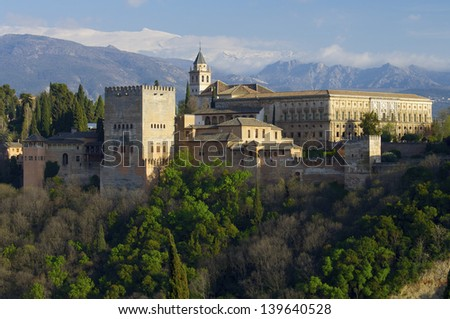 famous view of the Alhambra in Granada, the bottom of the image shows the mountains of Sierra Nevada, Andalusia, Spain - stock photo